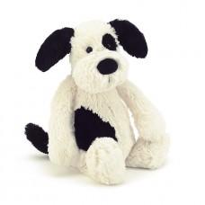 Gevlekte hond met rammelaar