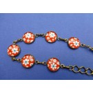 Armband met rode flower power